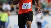 Yohan Blake from Jamaica races to a first place finish in the men's 100 metre dash at the Donovan Bailey Invitational track and field meet in Edmonton, Alberta, June 16, 2012. (TODD KOROL/REUTERS)