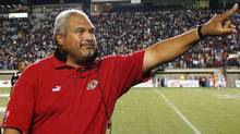 Ottawa Renegades head coach Joe Paopao celebrates his teams 43-38 win over the Montreal Alouettes in Ottawa Friday, Aug. 29, 2003 (The Canadian Press)
