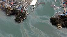 This aerial view taken on March 14, 2011 during an AFP-chartered flight shows traces of petrol floating on the surface of water in an area hit by the tsunami outside Sendai, in Miyagi prefecture three days after a massive 8.9 magnitude earthquake and tsunami devastated the coast of eastern Japan. Japan's government on March 15 urged people against panic-buying of food and supplies, as the country grapples with an earthquake and tsunami and resulting nuclear crisis. AFP PHOTO / NOBORU HASHIMOTO (Photo credit should read NOBORU HASHIMOTO/AFP/Getty Images) (Noboru Hashimoto/AFP/Getty Images/Noboru Hashimoto/AFP/Getty Images)
