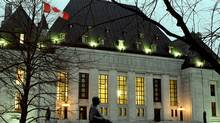 Supreme Court of Canada building in Ottawa at night (JIM YOUNG)