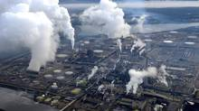 Plumes of smoke rise from an oil-sands upgrader facility north of Fort McMurray, Alta. (KEVIN VAN PAASSEN/THE GLOBE AND MAIL)