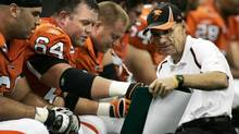Dan Dorazio(R), Offensive Line coach for the BC Lions, coaches Angus Reid on the sidelines against the Saskatchewan Roughriders during the Lions home June 16, 2006 at Pacific Coliseum in Vancouver. Dan Dorazio, offensive line coach of the B.C. Lions, is the man behind the ascendance of the new interior of the offensive line that has shown great improvement after a worrying start to the season. (Rafal Gerszak/Globe and Mail)