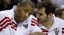 Toronto Raptors' Jamaal Magloire (left) talks with Jose Calderon on the bench during the second half of NBA basketball pre-season action against the Boston Celtics in Toronto on Sunday December 18, 2011. THE CANADIAN PRESS/Pawel Dwulit (Pawel Dwulit/CP)