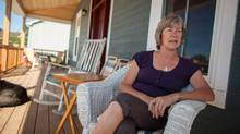 Beth Ross sits on the veranda of her newly constructed home in Goderich Ontario, Monday, August 20, 2012 on the eve of the one year anniversary of an F3 tornado which ripped through the heart of the lakeside community destroying her home along with many others on her street. (Geoff Robins/THE CANADIAN PRESS)