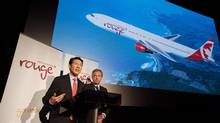 Executive vice-president Ben Smith, left, and chief executive officer of Air Canada Leisure Group, Michael Friisdahl unveil the new leisure airline Air Canada Rouge in Toronto in December. (Aaron Vincent Elkaim/THE CANADIAN PRESS)
