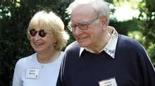 Warren Buffett, chairman of Berkshire Hathaway Inc., walks with his second wife, Astrid Menks, in 2006. (ELAINE THOMPSON/Associated Press)