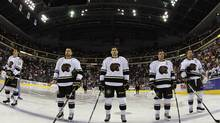 Members of the AHL's Hershey Bears starters stand on the blue line for the National Anthem, before the Bears take on the Binghamton Senators at the Giant Center in Hershey Pa. Sunday October 21, 2012. (CHRIS KNIGHT)