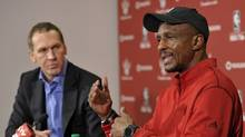 Toronto Raptors President and General Manager Bryan Colangelo and Head Coach Dwane Casey (R) discuss preparations for the Raptors' shortened 2011-2012 NBA basketball season during a news conference in Toronto December 7, 2011. (MIKE CASSESE/REUTERS)