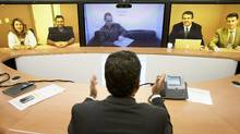 Ths president of Cisco Canada, Nitin Kawale, speaks with Cisco employees both in Ottawa and Toronto through a TelePresence machine in Cisco's Toronto office. (JENNIFER ROBERTS For The Globe and Mail)