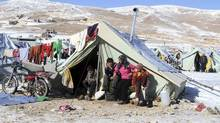 Host countries like Lebanon have been hard-pressed to manage the influx of Syrian refugees, a situation made worse by harsh weather in the region over the past week, including at this camp near the Lebanese border town of Arsal. (Ahmad Shalha/REUTERS)