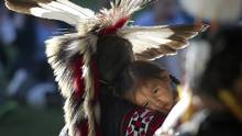 A small child gets a ride during the 101st Calgary Stampede in Calgary in 2013. (Kevin Van Paassen/The Globe and Mail)