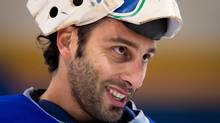 Vancouver Canucks' goalie Roberto Luongo smiles during an informal hockey practice with his teammates at the University of British Columbia in Vancouver, B.C., on Friday January 11, 2013. (DARRYL DYCK/THE CANADIAN PRESS)