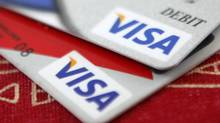 Visa Inc. has already raised it full-year earnings forecast twice this year, as more people move to card-based payments globally. (JASON REED/REUTERS)