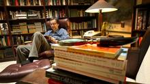 Guy Gavriel Kay reads in his library at his home in Toronto. (Kevin Van Paassen/Kevin Van Paassen / The Globe and Mail)