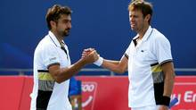 : Nenad Zimonjic (L) of Serbia and Daniel Nestor(R) of Canada After the victory celebration while playing Andrey Golubez of Kazakhstan and Denis Istomin of Uzbekistan during day Six of the 2010 China Open at the National Tennis Center on October 6, 2010 in Beijing, China. (Lintao Zhang/2010 Getty Images)