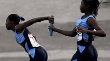 Athletes compete in the girl's 4x100m relay race at the Jamaica's Inter-Secondary Schools Boys and Girls Athletics Championships in Kingston March 28, 2012. (IVAN ALVARADO/REUTERS)