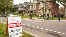 An open house sign is seen on Logan Avenue in Toronto's Riverdale neighbourhood on October 14, 2012. (JENNIFER ROBERTS For The Globe and Mail)