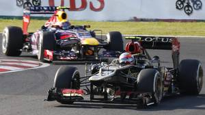 Lotus driver Romain Grosjean of France leads Red Bull driver Mark Webber of Australia during the Japanese Formula One Grand Prix, at the Suzuka circuit in Suzuka, Japan, Sunday, Oct. 13, 2013.