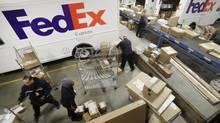 Shares of FedEx shot up 6.9 per cent on Wednesday. (Mark Lennihan/The Associated Press)