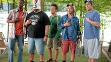 From left, Kurt (Chris Rock), Eric (Kevin James) with a KFC bucket on his head, Rob (Rob Schneider), Marcus (David Spade), Lenny (Adam Sandler) in Columbia Pictures' Grown Ups (Tracy Bennett)