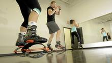 Jason Geall, co-ownder of Harmony Fitness in Toronto, practices with Kangoo, a rebound exercise shoes. (Fernando Morales/The Globe and Mail/Fernando Morales/The Globe and Mail)