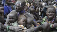 Internally displaced people are seen in Pibor Jan. 12, 2012. The World Food Program started distributing food to 60,000 internally displaced people in South Sudan, according to the United Nations Mission in South Sudan. (Isaac Billy/Reuters/Isaac Billy/Reuters)