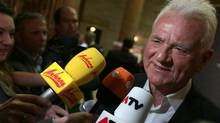 Frank Stronach's talks to media when arriving at the parliament for a TV discussion during national elections in Vienna, Austria, Sunday, Sept. 29, 2013. His party, Team Stronach was just one of the forces that rattled Austria's recent election. It cleared the 4-per cent hurdle needed to get into parliament with 5.8 per cent of the votes in Sunday's elections. (Matthias Schrader/AP)