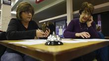 Volunteers make phone calls supporting the re-election of President Barack Obama at a campaign office in Lorain, Ohio November 1, 2012. (ERIC THAYER/REUTERS)