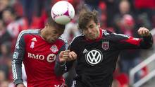 Toronto FC 's Ryan Johnson, left, battles for the ball with D.C. United's Dejan Jakovic during second half MLS action in Toronto on Saturday, October 6, 2012. (The Canadian Press)
