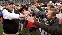 New York Jets coach Rex Ryan celebrates with fans after they defeated the Buffalo Bills in their final National Football League regular season game in East Rutherford, New Jersey, January 2, 2011. The Jets won 38-7. REUTERS/Ray Stubblebine (RAY STUBBLEBINE)