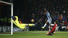 Manchester City's Raheem Sterling launches the ball into Bournemouth's net to open the scoring in their match on Monday at Vitality Stadium in Bournemouth, England. (Peter Nicholls/REUTERS)