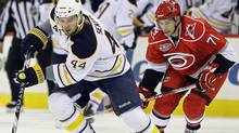 Buffalo Sabres' Andrej Sekera (44), of Slovakia, controls the puck as Carolina Hurricanes' Jerome Samson (71) chases during the first period of an NHL hockey game in Raleigh, N.C., Sunday, April 3, 2011. The Sabres won 2-1 in overtime. (AP Photo/Gerry Broome) (Gerry Broome)