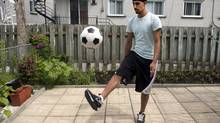 Aneel Samra, 18, plays with a soccer ball in his backyard in Montreal. Samra has not been able to play organized soccer since last year because of his religious headgear. (Ryan Remiorz/THE CANADIAN PRESS)