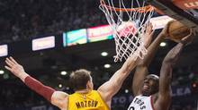Toronto Raptors centre Bismack Biyombo slam dunks the ball past Cleveland Cavaliers centre Timofey Mozgov during last night's game at the Air Canada Centre in Toronto. (Nathan Denette/THE CANADIAN PRESS)
