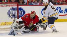 Buffalo Sabres center Steve Ott (9) shoots on Ottawa Senators goalie Craig Anderson (41) in the first period at the Canadian Tire Centre. (Marc DesRosiers-USA TODAY Sports/USA Today Sports)