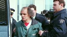 Clifford Olson is led away from court in Regina, Sask., April 4, 1996. During Kirk Makin's 1989 tour of Kingston Penitiary, Olson, a serial child murderer, was one of 31 dangerous convicts held in the prison's notorious E Block. (Roy Antal/THE CANADIAN PRESS)