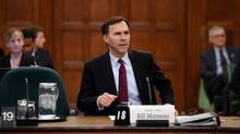 Finance Minister Bill Morneau appears at Commons committee for pre-budget consultations on Parliament Hill in Ottawa on Tuesday, Feb. 23, 2016. The federal budget is expected to run a significant deficit, which the government estimates will be $18-billion in fiscal year 2016-17. (Sean Kilpatrick/THE CANADIAN PRESS)