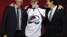 Nathan MacKinnon, stands with coach Patrick Roy (left) and executive vice president of hockey operations Joe Sakic after being chosen 1st overall in the first round of the NHL hockey draft, Sunday, June 30, 2013, in Newark, N.J. On Tuesday, the Avalanche signed MacKinnon to an entry-level contract. (Bill Kostroun/AP)