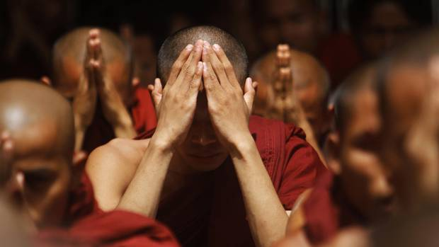 Rakhine Buddhist monks pray for peace at the Sule pagoda in central Yangon. The main subject surrounded by other monks praying gives the feeling that the image continues on outside the frame. Try using some creative cropping to make your images feel like they a small part of a larger scene. (Minzayar/REUTERS)