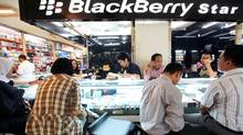 People buy BlackBerry phones at a shop in ITC Ambassador shopping mall in Jakarta. (Dimas Ardian for The Globe And Mail)