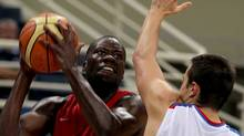 Denham Brown of Canada, left, jumps to score as Ivan Paunic of Serbia defends during the Acropolis basketball tournament at the indoor Olympic stadium of Athens, Wednesday, Aug. 18, 2010.(AP Photo/Thanassis Stavrakis) (Thanassis Stavrakis)