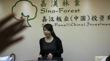 Staff are seen at the Sino-Forest and Sino-Panel China headquarters in Guangzhou, Southern China (ADAM DEAN FOR THE GLOBE AND MAIL)