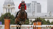 Canada's Tiffany Foster rides Victor during the equestrian individual jumping first qualifier in Greenwich Park at the London 2012 Olympic Games August 4, 2012.  (Reuters)