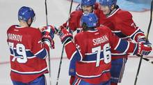 Montreal Canadiens Michael Ryder (73) celebrates his goal over Boston Bruins with teammates Brian Gionta (21), P.K. Subban (76) and Andrei Markov (79) during second period NHL action in Montreal, April 6, 2013. (CHRISTINNE MUSCHI/REUTERS)