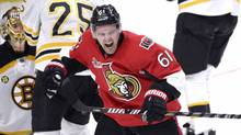 Ottawa Senators' Mark Stone (61) celebrates a goal scored by teammate Mike Hoffman against the Boston Bruins during third period NHL hockey action in Ottawa, on March 6, 2017. (Justin Tang/THE CANADIAN PRESS)