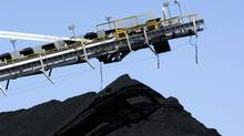 A stacker/reclaimer stockpiles coal at Rio Tinto's Blair Athol Mine in Queensland in this file photo. The company also produces coal in Mozambique, where Jindal Power & Steel has recently started production. (HO/REUTERS)