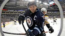 After a career-high 62 points in 81 games last season, Winnipeg Jets' Andrew Ladd has 13 goals and 17 assists in 55 games as the team struggles to enter the playoff picture. (Trevor Hagan/The Canadian Press)