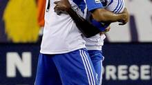 Montreal Impact defender Dennis Iapichino (17) celebrates with midfielder Sanna Nyassi, right, after Nyassi scored in the first half of an MLS soccer match against the New England Revolution, in Foxborough, Mass., Sunday, Aug. 12, 2012. The Impact won 1-0. (Steven Senne/AP)