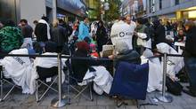 Customers camp outside an Apple store before the release of iPhone 5 in Munich early Sept. 21, 2012. (MICHAEL DALDER/REUTERS)