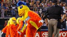 The San Diego Chicken lifts his leg toward the home-plate umpire during Padres game against the Colorado Rockies at Qualcomm Stadium on Sept. 26, 2003. (LENNY IGNELZI/AP)